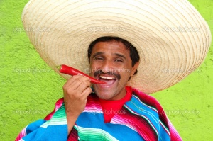 depositphotos_5397635-Mexican-man-poncho-sombrero-eating-red-hot-chili